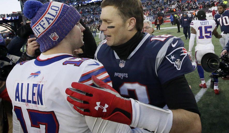 Buffalo Bills quarterback Josh Allen, left, and New England Patriots quarterback Tom Brady speak at midfield after an NFL football game, Sunday, Dec. 23, 2018, in Foxborough, Mass. (AP Photo/Steven Senne)