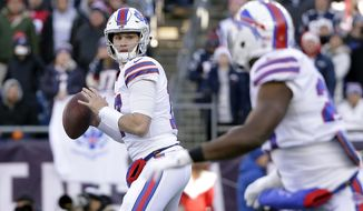 Buffalo Bills quarterback Josh Allen, left, prepares to pass to running back LeSean McCoy, right, during the first half of an NFL football game against the New England Patriots, Sunday, Dec. 23, 2018, in Foxborough, Mass. (AP Photo/Steven Senne)