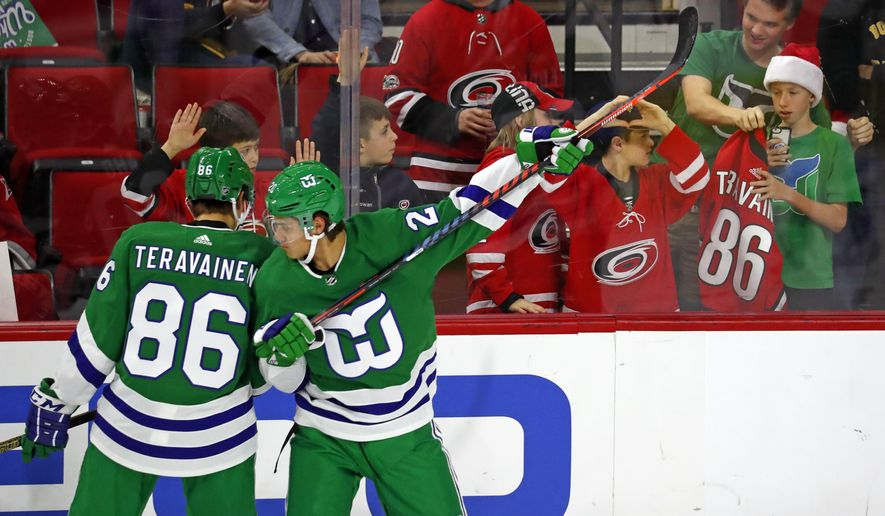 adaf115b3 Aho leads Carolina past Bruins 5-3 on Whalers Night - Washington Times