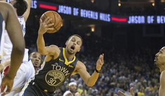 Golden State Warriors guard Stephen Curry (30) gets a rebound against the Los Angeles Clippers in the second quarter of an NBA basketball game, Sunday, Dec. 23, 2018, in Oakland, Calif. (AP Photo/John Hefti)