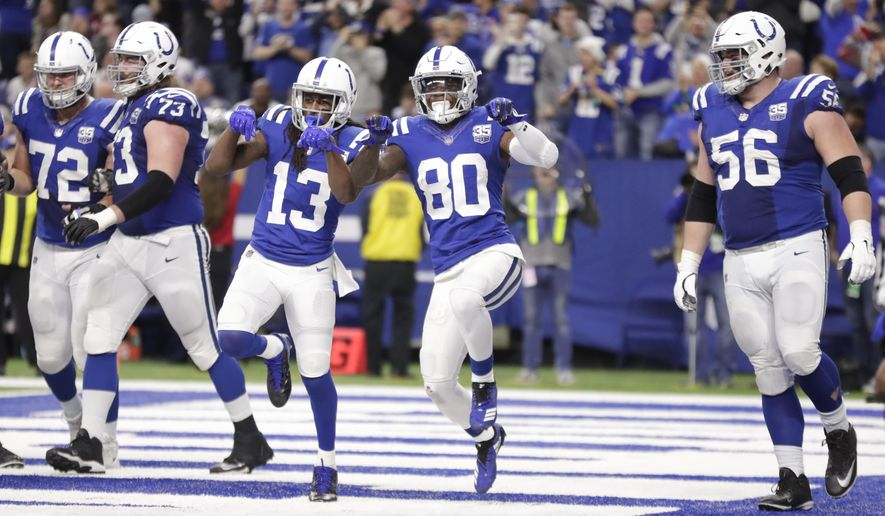 Indianapolis Colts wide receiver Chester Rogers (80) celebrates his game-winning touchdown with wide receiver T.Y. Hilton (13) during the second half of an NFL football game against the New York Giants in Indianapolis, Sunday, Dec. 23, 2018. The Colts defeated the Giants 28-27. (AP Photo/Michael Conroy)