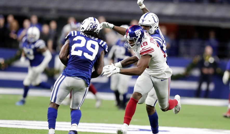 Indianapolis Colts free safety Malik Hooker (29) intercepts a pass intended for New York Giants wide receiver Bennie Fowler (18) in the closing seconds in the second half of an NFL football game in Indianapolis, Sunday, Dec. 23, 2018. (AP Photo/Michael Conroy)