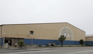 This undated photo, shows the building that housed the Lone Star Flight Museum in Galveston, Texas, which moved to Houston. The building that was swamped in 2008 during Hurricane Ike has been sold. (Jennifer Reynolds/The Galveston County Daily News via AP)