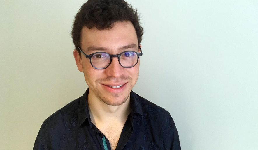 In this Sept. 12, 2018 photo, Duolingo CEO Luis von Ahn poses for a portait in Cambridge, Mass. (AP Photo/Matt O'Brien)