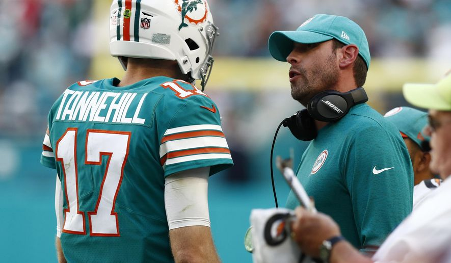 Miami Dolphins head coach Adam Gase talks to quarterback Ryan Tannehill (17), during the second half at an NFL football game against the Jacksonville Jaguars, Sunday, Dec. 23, 2018, in Miami Gardens, Fla. (AP Photo/Brynn Anderson)
