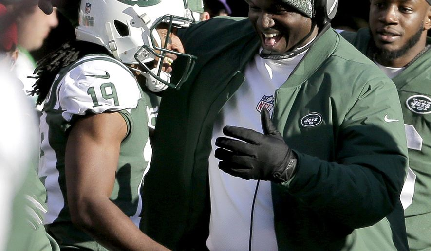 New York Jets' Andre Roberts, left, is congratulated by head coach Todd Bowles after returning a Green Bay Packers kickoff for a touchdown during the first half of an NFL football game, Sunday, Dec. 23, 2018, in East Rutherford, N.J. (AP Photo/Seth Wenig)