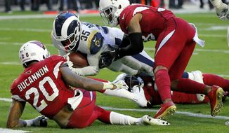 Los Angeles Rams running back C.J. Anderson (35) scores a touchdown as Arizona Cardinals outside linebacker Deone Bucannon (20) and Arizona Cardinals defensive back David Amerson defend during the first half of an NFL football game, Sunday, Dec. 23, 2018, in Glendale, Ariz. (AP Photo/Rick Scuteri)