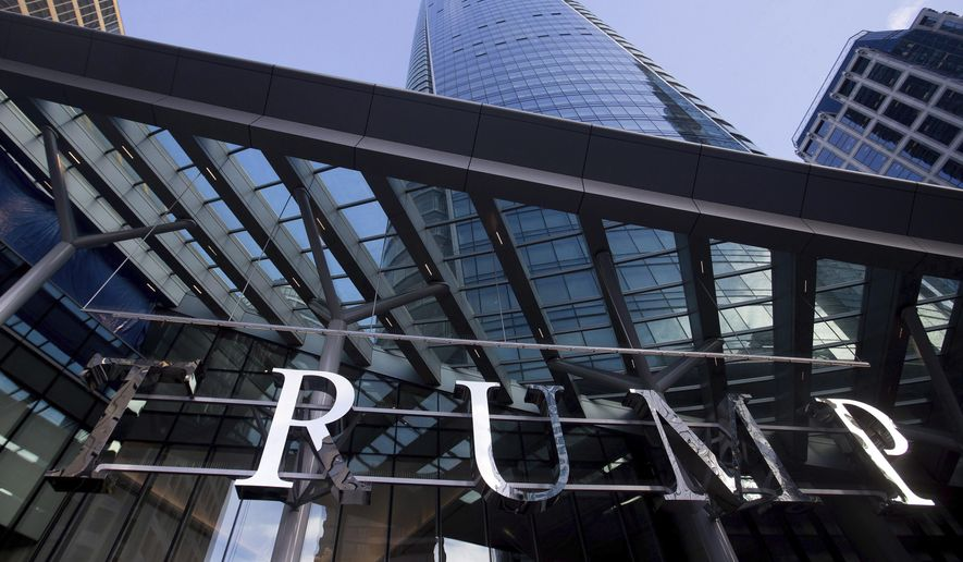 This Jan. 20, 2017 file photo shows the still-under-construction Trump International Hotel and Tower in Vancouver, British Columbia, Canada. Although condominium prices in the 69-story tower have set records, there is mounting evidence that the Trump brand has been hurt by the president's divisive comments. (Darryl Dyck/The Canadian Press via AP)