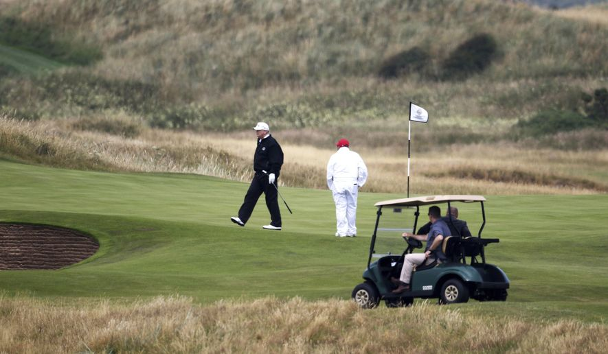 In this July 14, 2018, file photo, President Donald Trump walks off the 4th green while playing at Turnberry golf club in Turnberry, Scotland. (AP Photo/Peter Morrison, File)