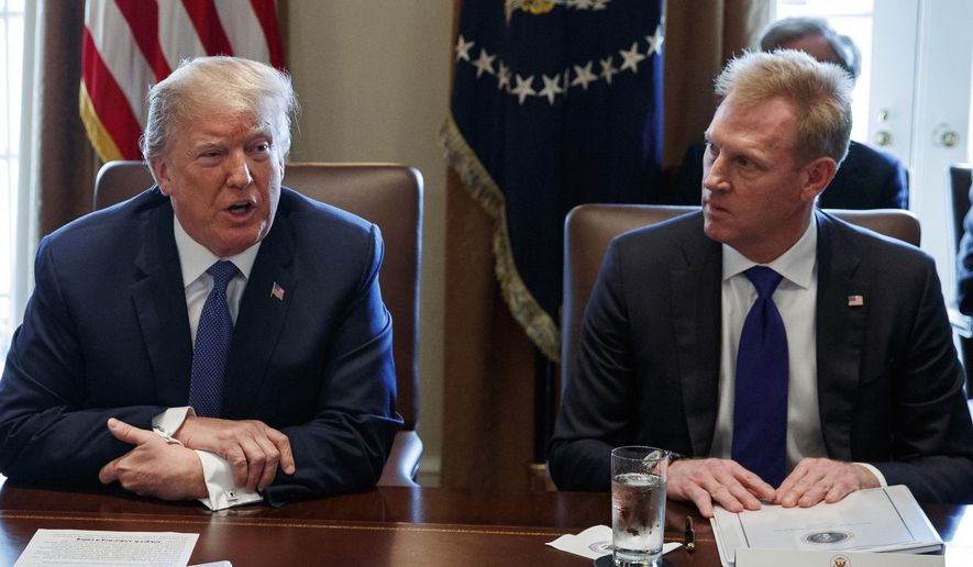 FILE - In this April 9, 2018, file photo, Deputy Secretary of Defense Patrick Shanahan, right, listen as President Donald Trump speaks during a cabinet meeting at the White House, in Washington. A U.S. administration official says that Defense Secretary Jim Mattis will leave his post Jan. 1, 2019, as Trump is expected to name Shanahan as acting secretary. (AP Photo/Evan Vucci, File)