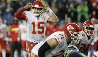Kansas City Chiefs quarterback Patrick Mahomes (15) signals to his team during the second half of an NFL football game against the Seattle Seahawks, Sunday, Dec. 23, 2018, in Seattle. (AP Photo/Elaine Thompson)
