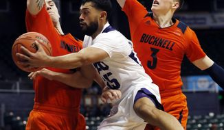 TCU guard Alex Robinson (25) makes a pass around Bucknell forward Nate Sestina (4) and guard Jimmy Sotos (3) during the second half of an NCAA college basketball game at the Diamond Head Classic, Sunday, Dec. 23, 2018, in Honolulu. (AP Photo/Marco Garcia)