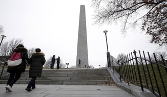 Visitors approach the Bunker Hill Monument, Monday, Dec. 24, 2018, in Boston. The historic site, erected to commemorate the Revolutionary War Battle of Bunker Hill, and run by the National Park Service, was closed Monday due to a partial federal government shutdown. The federal government is expected to remain partially closed past Christmas Day in a protracted standoff over President Donald Trump's demand for money to build a border wall with Mexico. (AP Photo/Steven Senne)