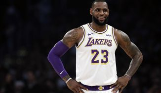 Los Angeles Lakers' LeBron James (23) smiles during a break in action during the first half of an NBA basketball game against the Memphis Grizzlies Sunday, Dec. 23, 2018, in Los Angeles. (AP Photo/Marcio Jose Sanchez)