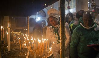 Christian worshippers light candles at the Church of the Nativity, traditionally recognized by Christians to be the birthplace of Jesus Christ, in the West Bank city of Bethlehem, Sunday, Dec. 23, 2018. (AP Photo/Nasser Nasser) ** FILE **