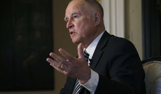FILE - In this Tuesday, Dec. 18, 2018 file photo, California Gov. Jerry Brown talks during an interview in Sacramento, Calif. Brown ordered new DNA tests that, condemned inmate Kevin Cooper says, could clear him in a 35-year-old quadruple murder case, which has drawn national attention. On Monday, Dec. 24, 2018, Brown ordered new testing on four pieces of evidence that Cooper and his attorneys say will show he was framed for the 1983 Chino Hills hatchet and knife killings of four people. (AP Photo/Rich Pedroncelli, File)