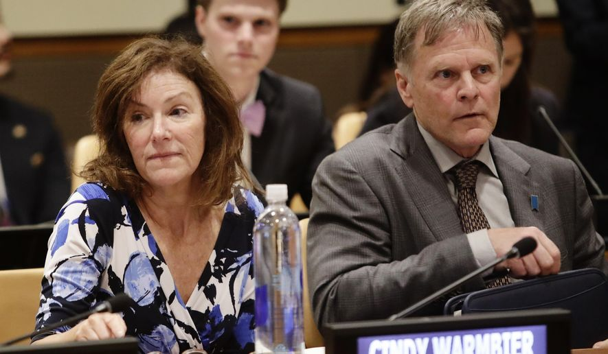In this May 3, 2018, file photo, Fred Warmbier, right, and Cindy Warmbier, parents of Otto Warmbier, wait for a meeting at the United Nations headquarters. (AP Photo/Frank Franklin II, File)