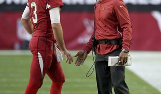 Arizona Cardinals head coach Steve Wilks greets quarterback Josh Rosen (3) during the first half of an NFL football game against the Los Angeles Rams, Sunday, Dec. 23, 2018, in Glendale, Ariz. (AP Photo/Ross D. Franklin)