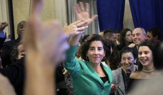 FILE -- In this Tuesday, Nov. 6, 2018 file photo, Rhode Island Democrat Gov. Gina Raimondo, center, celebrates her victory over Cranston, R.I., Mayor Republican Allan Fung in the race for governor, in Providence, R.I. Raimondo's re-election was among the state's top stories in 2018. (AP Photo/Steven Senne, File)