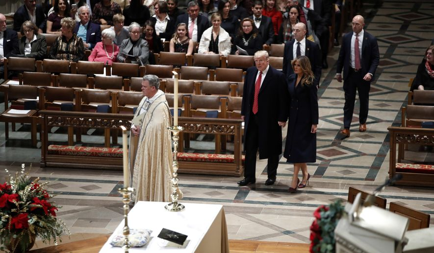 President Donald Trump and first lady Melania Trump arrive for a Christmas Eve service at the National Cathedral, Monday, Dec. 24, 2018, in Washington. (AP Photo/Jacquelyn Martin)