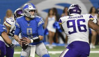 Minnesota Vikings defensive tackle Tom Johnson (96) and defensive end Everson Griffen (97) close in on Detroit Lions quarterback Matthew Stafford (9) during the second half of an NFL football game, Sunday, Dec. 23, 2018, in Detroit. (AP Photo/Jose Juarez)