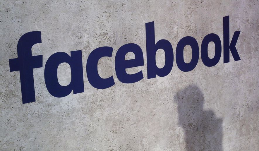 A Facebook logo is displayed in a start-up companies gathering at Paris' Station F, in Paris. (AP Photo/Thibault Camus, File)