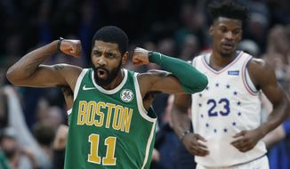 Boston Celtics' Kyrie Irving (11) reacts in front of Philadelphia 76ers' Jimmy Butler after making a 3-pointer in overtime during an NBA basketball game in Boston, Tuesday, Dec. 25, 2018. Boston won 121-114. (AP Photo/Michael Dwyer)