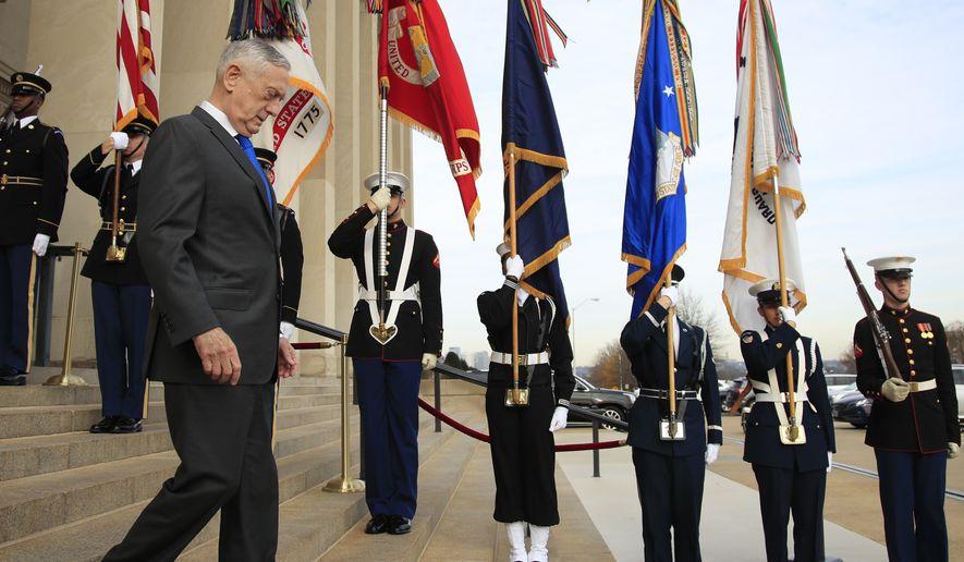 Defense Secretary Jim Mattis walks down the steps of the Pentagon, Wednesday, Dec. 19, 2018. (AP Photo/Manuel Balce Ceneta)