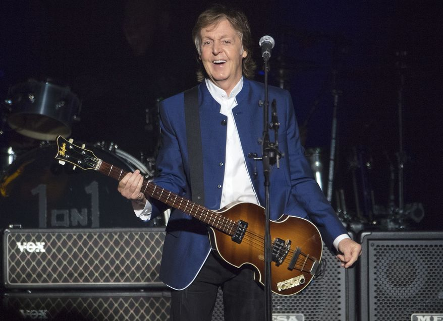 In this Monday, July 10, 2017, file photo, Sir Paul McCartney performs at Amalie Arena in Tampa, Fla. Most hosts would be quite happy to have Paul McCartney come to a shindig. Paul McCartney's Christmas message to his fans around the world: Don't be like me and eat and drink too much. The 76-year-old former Beatle tweeted his lighthearted holiday wishes Tuesday, Dec. 25, 2018, illustrated with photos from his younger days. (AP Photo/Scott Audette, file)