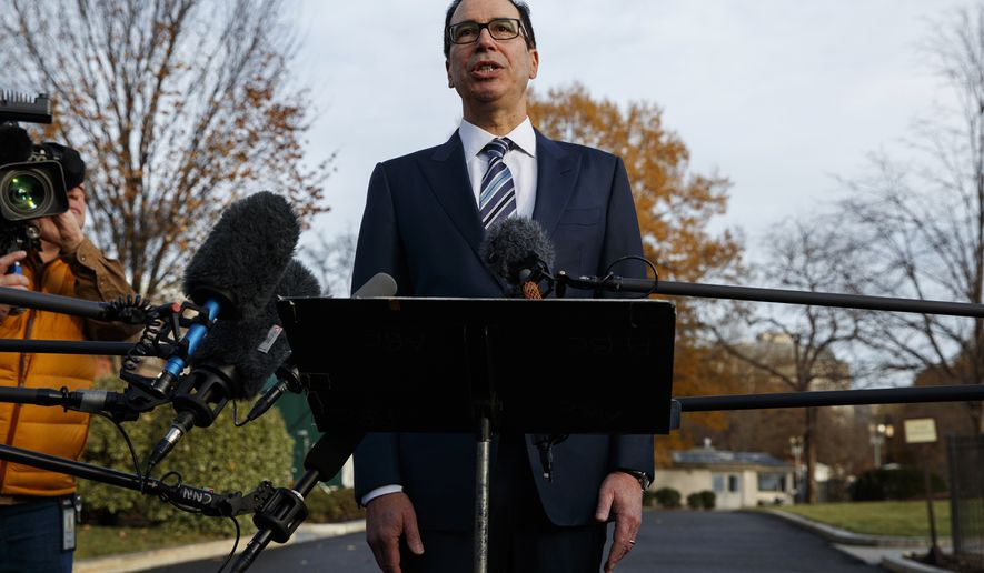 """In this Dec. 3, 2018, file photo, Treasury Secretary Steve Mnuchin talks with reporters at the White House in Washington. Trump says he has confidence in Mnuchin, calling him a """"very talented guy"""" and a """"very smart person."""" (AP Photo/Evan Vucci) **FILE**"""