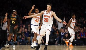 New York Knicks forward Kevin Knox (20) celebrates after making a 3-point basket against the Atlanta Hawks during the first half of an NBA basketball game Friday, Dec. 21, 2018, in New York. (AP Photo/Adam Hunger)