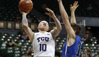 TCU guard Jaylen Fisher (10) tries to shoot over Indiana State guard Clayton Hughes (13) during the first half of an NCAA college basketball game at the Diamond Head Classic Tuesday, Dec. 25, 2018, in Honolulu. (AP Photo/Marco Garcia)