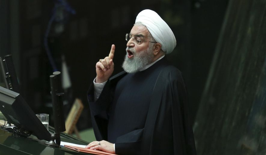 Iranian President Hassan Rouhani speaks as he submits next year's budget bill to parliament in Tehran, Iran, Tuesday, Dec. 25, 2018. The $47.5 billion budget is less than half of last year's, mainly due to the severe depreciation of the local currency following President Donald Trump's decision to withdraw from the 2015 nuclear deal and restore U.S. sanctions. (AP Photo/Vahid Salemi)
