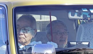 Yoichi Kitamura, right, a lawyer representing former Nissan executive Greg Kelly, leaves Tokyo Detention Center, where former Nissan chairman Carlos Ghosn and Kelly, are being detained, in Tokyo Tuesday, Dec. 25, 2018. Nissan's former chairman Ghosn and another executive Kelly were arrested Nov. 19 and charged with underreporting Ghosn's income for 2011-2015 by about 5 billion yen ($44 million). Kelly's bail request filed by his lawyer on Friday, Dec. 21, is still pending and could come sometime after Christmas. (AP Photo/Eugene Hoshiko)