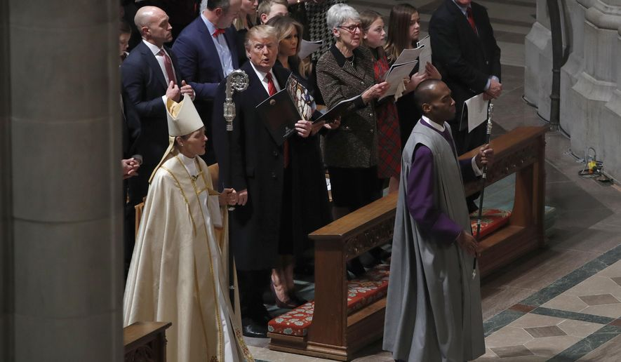 President Donald Trump and first lady Melania Trump attend a Christmas Eve service at the National Cathedral, Monday, Dec. 24, 2018, in Washington. (AP Photo/Jacquelyn Martin)