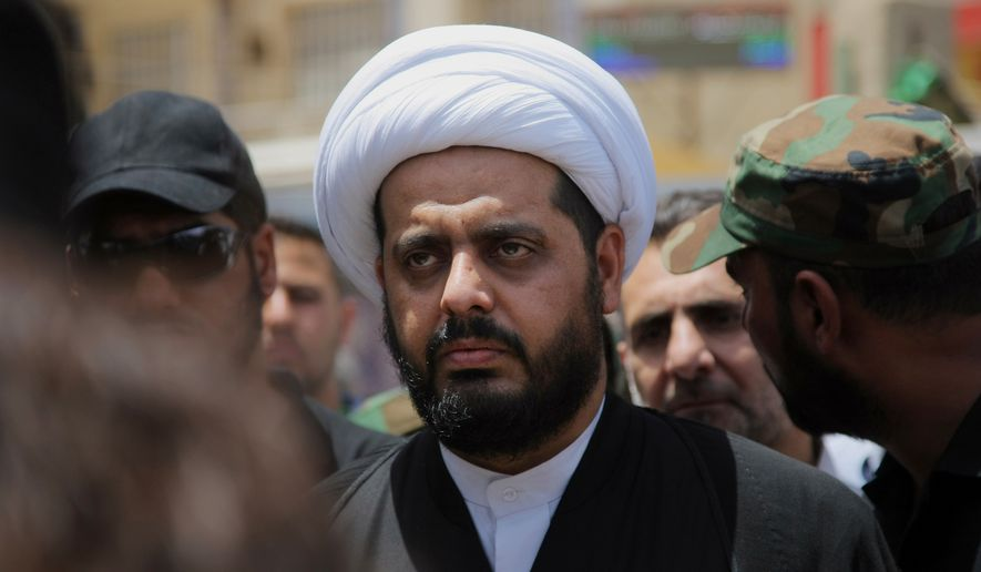 Qais al-Khazali, center, the leader of the Shiite group Asaib Ahl al-Haq, or League of the Righteous, leads the funeral procession for his 15 militiamen who were killed in Beiji, Iraq, from fighting with Islamic State militants, according to their families, in Najaf, 100 miles (160 kilometers) south of Baghdad, Monday, June 8, 2015. (AP Photo/Jaber al-Helo)