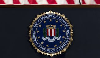 In this June 14, 2018, file photo, the FBI seal is seen before a news conference at FBI headquarters in Washington.  (AP Photo/Jose Luis Magana, File)