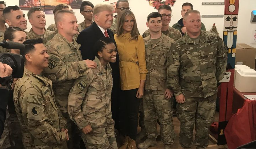 President Trump and wife Milenia visit troops in Iraq during Christmas in this photo tweeted from the White House account of Press Secretary Sarah Sanders.