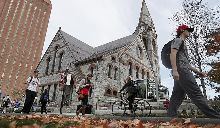 Students pass the Old Chapel at the University of Massachusetts campus in Amherst on Oct. 21, 2016. (Associated Press/Suzanne Kreiter) ** FILE **