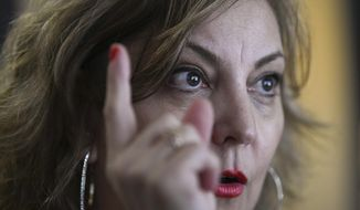 """In this Dec. 19, 2018 photo, congressional aide Claudia Guebel speaks during an interview, in Buenos Aires, Argentina. At the beginning of this year, she said, Pedro Fiorda, a senator's chief of staff, grabbed her violently by the arms like a """"hunter who catches prey."""" Then, she felt his tongue inside her mouth. The terror that seized her made those minutes seem eternal, she said. (AP Photo/Gustavo Garello)"""