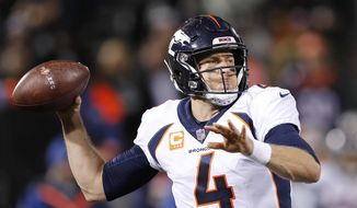 Denver Broncos quarterback Case Keenum (4) passes against the Oakland Raiders during the first half of an NFL football game in Oakland, Calif., Monday, Dec. 24, 2018. (AP Photo/John Hefti) **FILE**