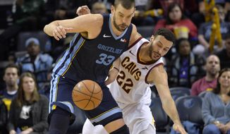 Memphis Grizzlies center Marc Gasol (33) and Cleveland Cavaliers forward Larry Nance Jr. (22) struggle for control of the ball during the second half of an NBA basketball game Wednesday, Dec. 26, 2018, in Memphis, Tenn. (AP Photo/Brandon Dill)