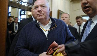 FILE - In this Feb. 24, 2016, file photo, Michael Skakel leaves the Connecticut Supreme Court after his hearing in Hartford, Conn. The state Supreme Court in May 2018 vacated Skakel's conviction in the bludgeoning death of Martha Moxley in their wealthy Greenwich neighborhood in 1975 when they were teenagers. The turn in Skakel's decades-long legal saga was among the state's top stories in 2018. (AP Photo/Jessica Hill, File)