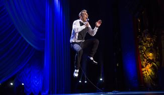 This  May 7, 2016, photo provided by Essential Broadcast Media LLC shows Sebastian Maniscalco  performing at the Beacon Theater in New York. Maniscalco has a perfect matchup in mind for the Super Bowl: Bears vs. Texans. Could happen. The native of Chicago and lifelong Bears fan also is close friends with Houston star defensive end J.J. Watt. (Todd Rosenberg/Essential Broadcast Media LLC via AP)