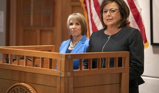 FILE - In this Nov. 9, 2018, file photo, New Mexico Gov. Susana Martinez, right, and U.S. Rep. Michelle Lujan Grisham, who was elected in November as the state's next governor, hold a joint press conference following a meeting at the State Capitol in Santa Fe, N.M. Martinez, a Republican and the state's first female governor, has served two consecutive terms. Lujan Grisham, a Democrat, will take office Jan. 1, 2019. (AP Photo/Craig Fritz, File)