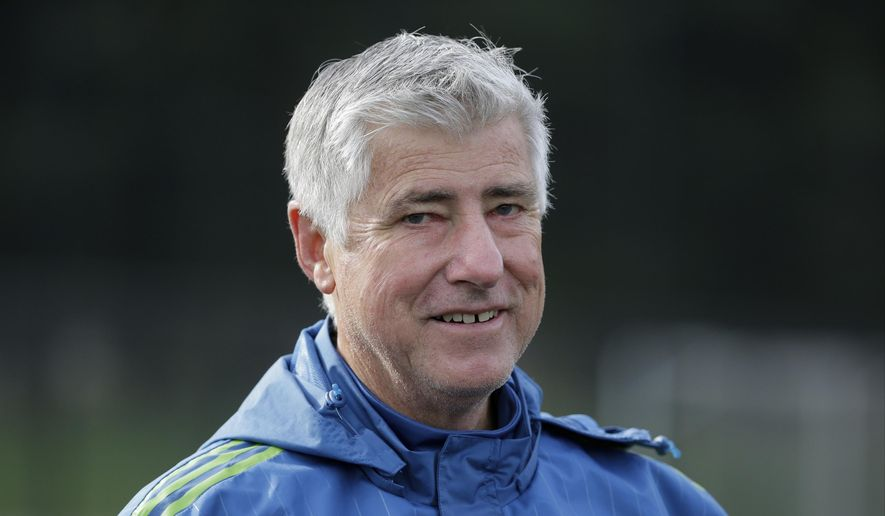 FILE - In this Oct. 27, 2015, file photo, Seattle Sounders coach Sigi Schmid walks off the field following an MLS soccer training session in Tukwila, Wash. Schmid, the winningest coach in MLS history, has died. He was 65. Schmid's family said he died Tuesday, Dec. 25, 2018, at Ronald Reagan UCLA Medical Center in Los Angeles. Schmid was hospitalized three weeks ago as he awaited a heart transplant. (AP Photo/Ted S. Warren, File) **FILE**