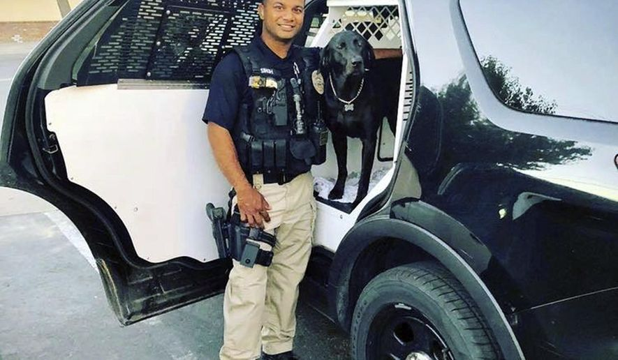 """This undated photo provided by the Newman Police Department shows officer Ronil Singh of Newman Police Department who was killed by an unidentified suspect. The Stanislaus County Sheriff's Department said Singh was conducting a traffic stop early Wednesday, Dec. 26, 2018, in the town of Newman, Calif. when he called out """"shots fired"""" over his radio. (Stanislaus County Sheriff's Department via AP)"""