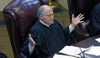 "FILE - This Nov. 29, 2017, file photo shows Mississippi Supreme Court Chief Justice William Waller Jr., in court in Jackson, Miss. The chief justice of the Mississippi Supreme Court says he will retire from the bench Jan. 3, 2019. The 66-year-old Waller says he is in good health and ""it's just time"" to step away from public service. He will have served 21 years on the Supreme Court, with the last 10 as chief justice. (AP Photo/Rogelio V. Solis, file)"