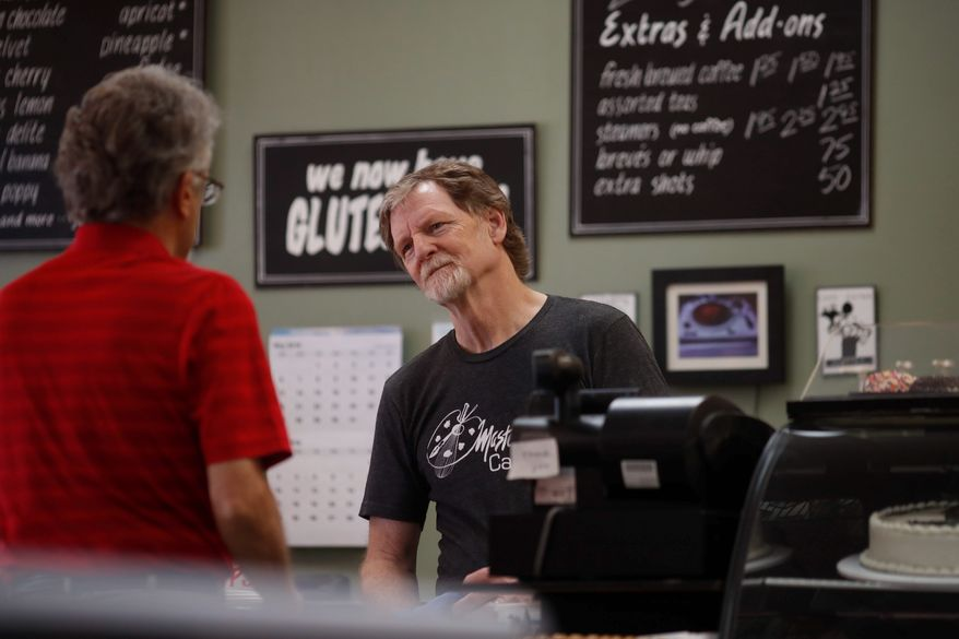 Baker Jack Phillips, owner of Masterpiece Cakeshop, manages his shop after the U.S. Supreme Court ruled that he could refuse to make a wedding cake for a same-sex couple because of his religious beliefs did not violate Colorado's anti-discrimination law Monday, June 4, 2018, in Lakewood, Colo. (AP Photo/David Zalubowski) ** FILE **