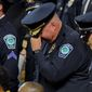 More police officers have died in the line of duty this year than in 2017. That's according to data compiled by the National Law Enforcement Officers Memorial Fund. The organization said in a report Thursday that 144 federal, state and local officers have died so far in 2018. Last year 129 died. (ASSOCIATED PRESS PHOTOGRAPHS)